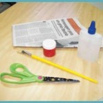 1. Material: folhas de jornal, cola, pincel, tesoura, tinta guache.